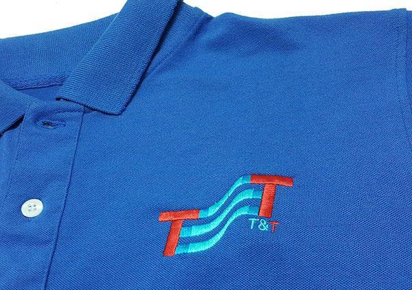 Thêu áo đồng phục tại Bình Dương logo T&T.